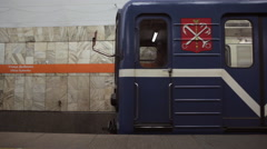 Metro train leaving Ulitsa Dybenko subway station in Saint Petersburg Russia Stock Footage