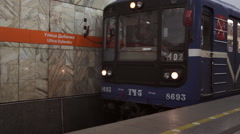Metro train arriving Ulitsa Dybenko subway station in Saint Petersburg Russia Stock Footage