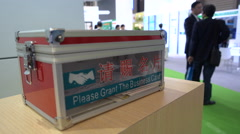 Business people can drop their cards in a box, trade show in Shanghai, China Stock Footage