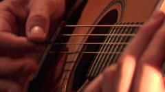 Hands of young man playing acoustic guitar Stock Footage