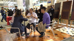 Business people discuss cooperation at meeting trade show China Stock Footage
