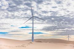 Two wind turbines in desert landscape, Taiba, Ceara, Brazil Stock Photos