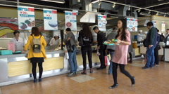 People take a lunch break in restaurant of trade show Shanghai China Stock Footage