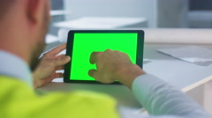 Engineer using Tablet Computer with Green Screen on Construction. Stock Footage