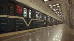 Metro train arriving at Kirovsky zavod subway station in Saint Petersburg Russia Stock Footage