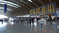 Schedule board in departure hall Shanghai airport, transportation China Stock Footage