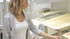 Woman measuring the furniture size at store Stock Footage