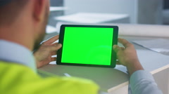 Engineer Holding Tablet Computer with Green Screen inside Building. Stock Footage