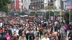 Massive crowds walk through popular shopping street in Shanghai, China Stock Footage