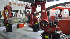 Production robots at a technology fair in Shanghai, China Stock Footage