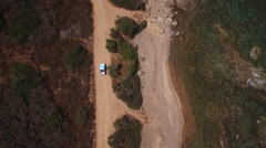 AERIAL SHOT OF A CAR DRIVING NEAR THE BEACH Stock Footage