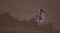 AERIAL TOP SHOT OF A BEAUTIFUL GIRL ON THE BEACH Stock Footage