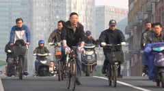 Motorbikes ride over a bridge, early morning commute in Shanghai, China Stock Footage