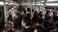 People travel on the busy subway during morning rush hour in Shanghai, China Stock Footage