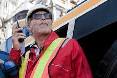Engineer using walkie talkie on oil rig Stock Photos