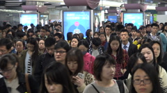 Business people exit the metro station during rush hour in Shanghai, China Stock Footage