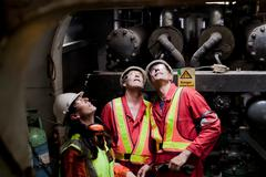Engineers working on oil rig Stock Photos