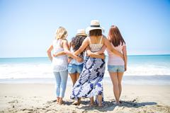 Rear view of four adult female friends strolling on beach, Malibu, California, Stock Photos