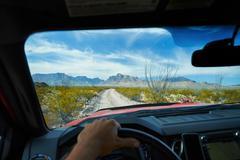 Man driving off road vehicle along dirt track, Big Bend National Park, Texas, Stock Photos