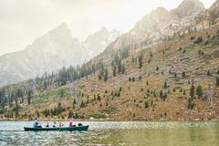 Family with four children paddling canoe on lake, Grand Teton National Park, Stock Photos