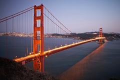 View of traffic light trails crossing Golden Gate Bridge at dusk, San Francisco, Stock Photos