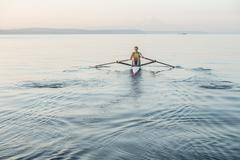Man rowing row boat in sea around Bainbridge Island, Washington, USA Stock Photos