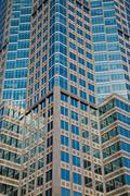 Low angle view of glass fronted building, Montreal, Quebec, Canada Stock Photos