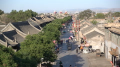 Overview of a commercial street in the ancient walled city of Pingyao, China Stock Footage
