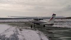 Airplane standing on a runway. Stock Footage