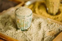 Close Grated Nutmeg Fragrant Seasoning Condiment In Glass In Tra Stock Photos