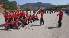 Martial arts students at the training grounds of the Shaolin complex in China Stock Footage