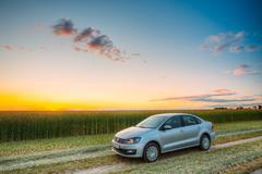 Volkswagen Polo Car Parking On Wheat Field. Sunset Sunrise Drama Stock Photos