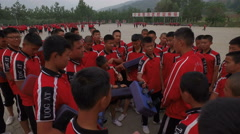 Martial arts coach talks to students at kung fu institute Shaolin, China Stock Footage