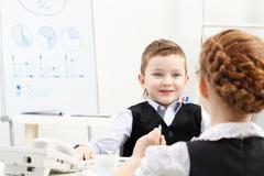 Kids negotiating business Stock Photos