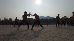 Silhouettes of martial arts students boxing, training at kung fu school China Stock Footage
