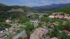 Road bridge in rock mountain tunnel up railway bridge in city 4k aerial drone Stock Footage