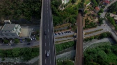 Overpass bridge road of multi level interchange junction in a small coastal city Stock Footage