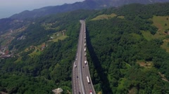 Highway bridge mountain viaduct road cars lorry truck aerial 4k above top view Arkistovideo