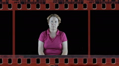 Mature woman showing sleepy emotion in film reel Stock Footage
