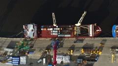 Aerial view of a ship in port under loading Stock Footage