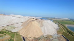 4k areal waste tailings piles above potash mines and basins by salt extraction  Stock Footage