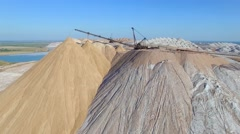 4k areal waste tailings piles above potash mines and water basins close up Stock Footage