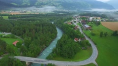 Mountain river valley town houses and road 4k aerial bird eye view above Stock Footage