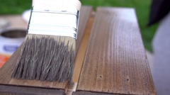 Woman painting wooden box with a brush Stock Footage