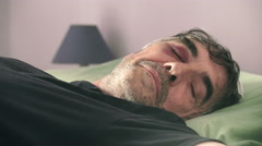 Man who has just undergone surgery to his head, recovering at home Stock Footage