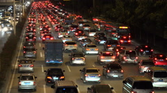Red tail lights of cars driving over a highway in Shenzhen at night Stock Footage