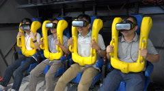 Chinese men wear virtual reality glasses, roller coaster ride gaming industry Stock Footage