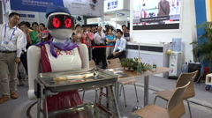 Humanoid robots function as waitresses in restaurant, trade show China Stock Footage