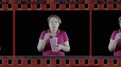Mature woman showing shock emotion in film strip Stock Footage