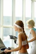 Women on treadmill Stock Photos